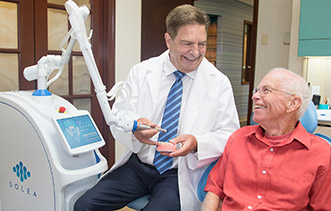 Dr. Davidson uses a dental laser to provide minimally invasive treatment whenever possible.