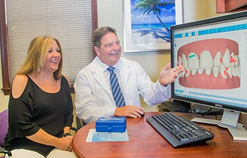 Patient with doctor looking at invisalign